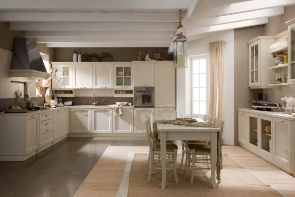 Country-style kitchen. Newport brings to the kitchen that bygone style of a time when the house shared a special familiarity with nature. The oak slatted door with pinstripe finish or open-pore lacq